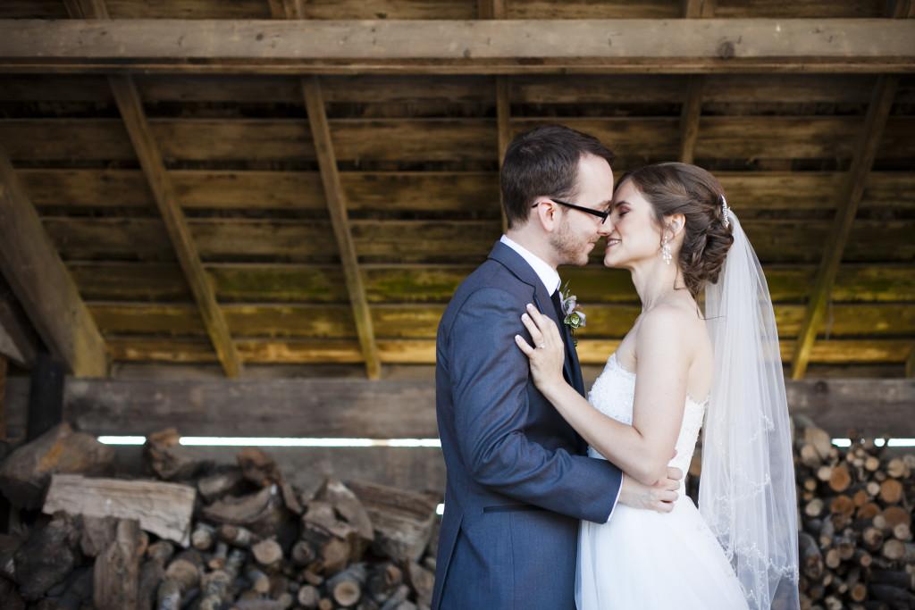 bride and groom barn portrait