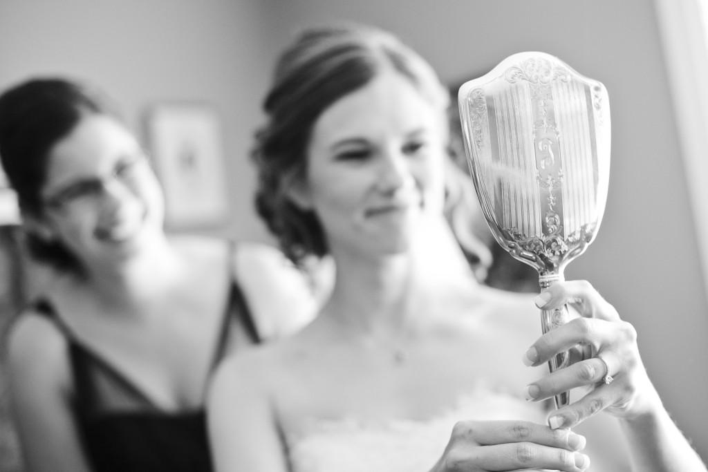 bride looking in grandmother's mirror, chilliwack wedding