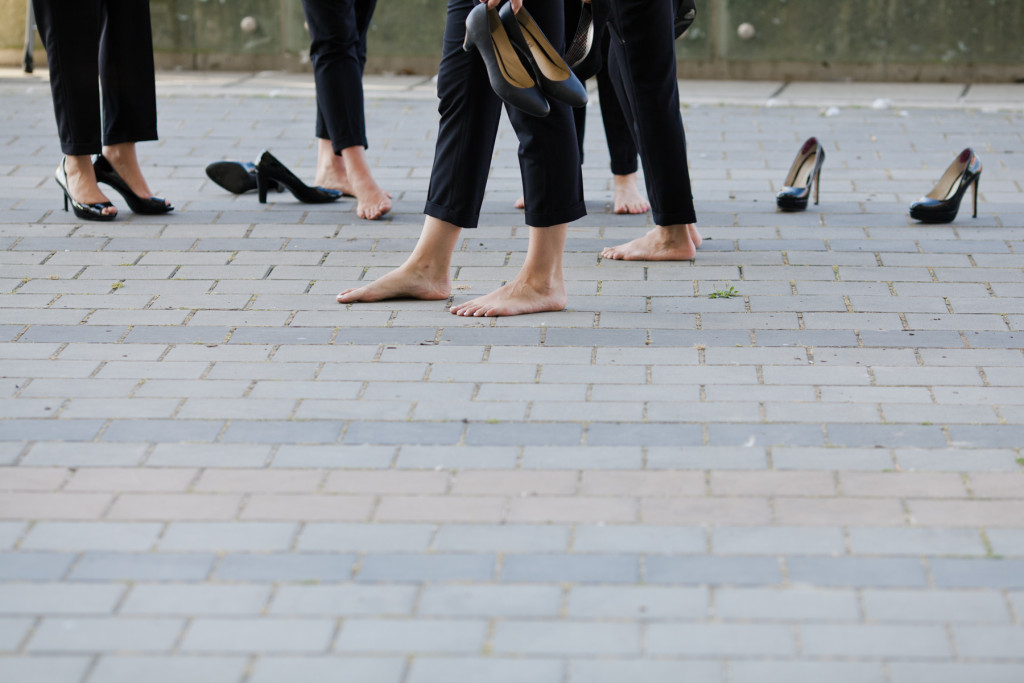 bridesmaids in suits with shoes off