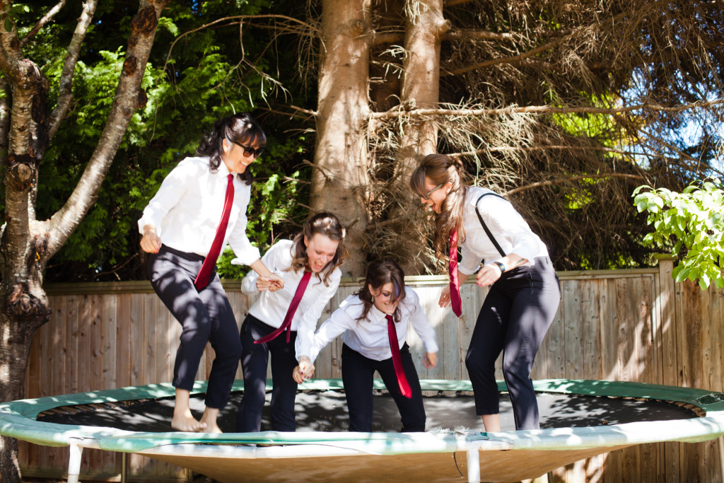 bridesmaids in suits on trampoline