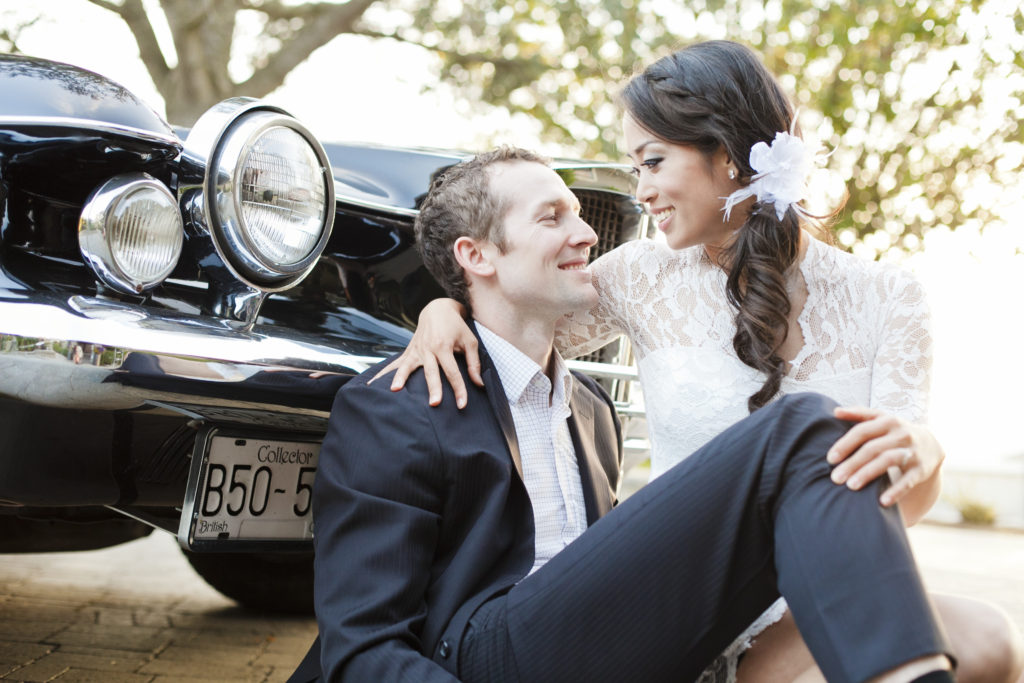 couple with vintage collector car