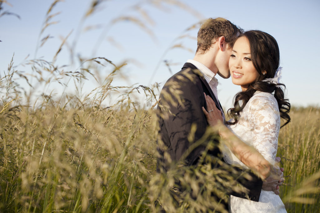 fraser valley engagement session in field of tall grass