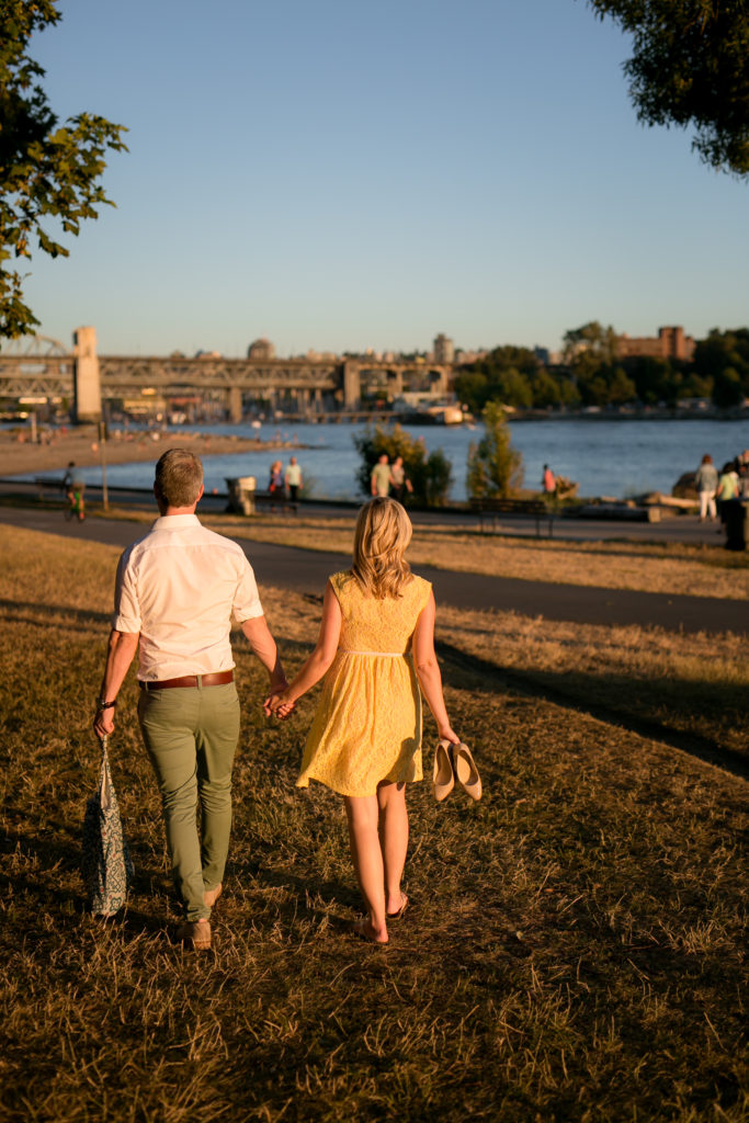 couple walking at english bay sunset