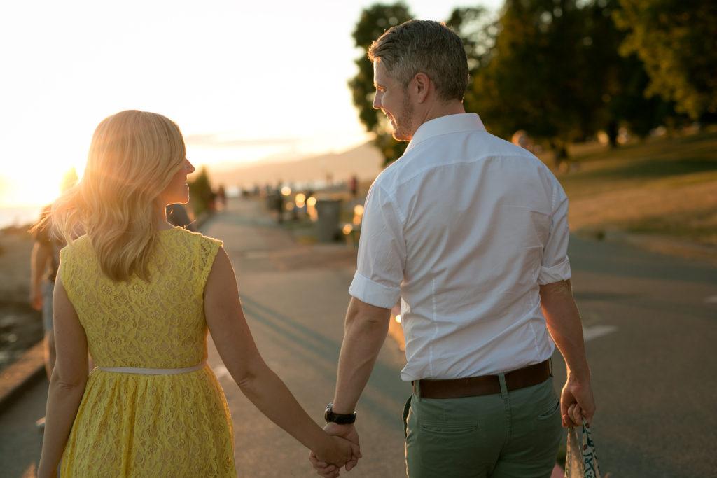 walking couple english bay engagement at sunset