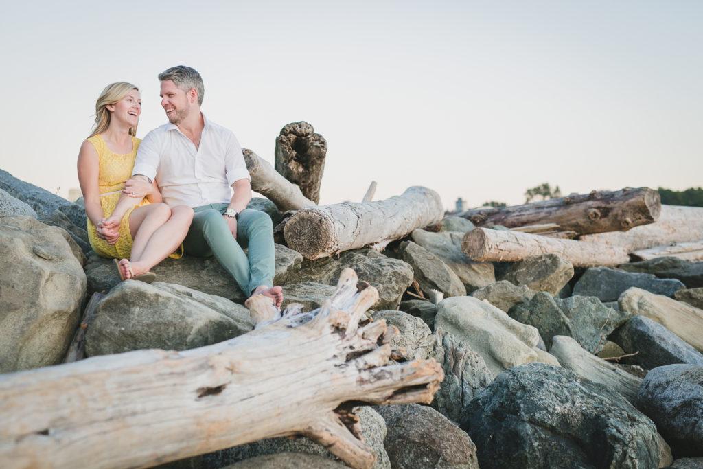 english bay engagement photos vancouver driftwood