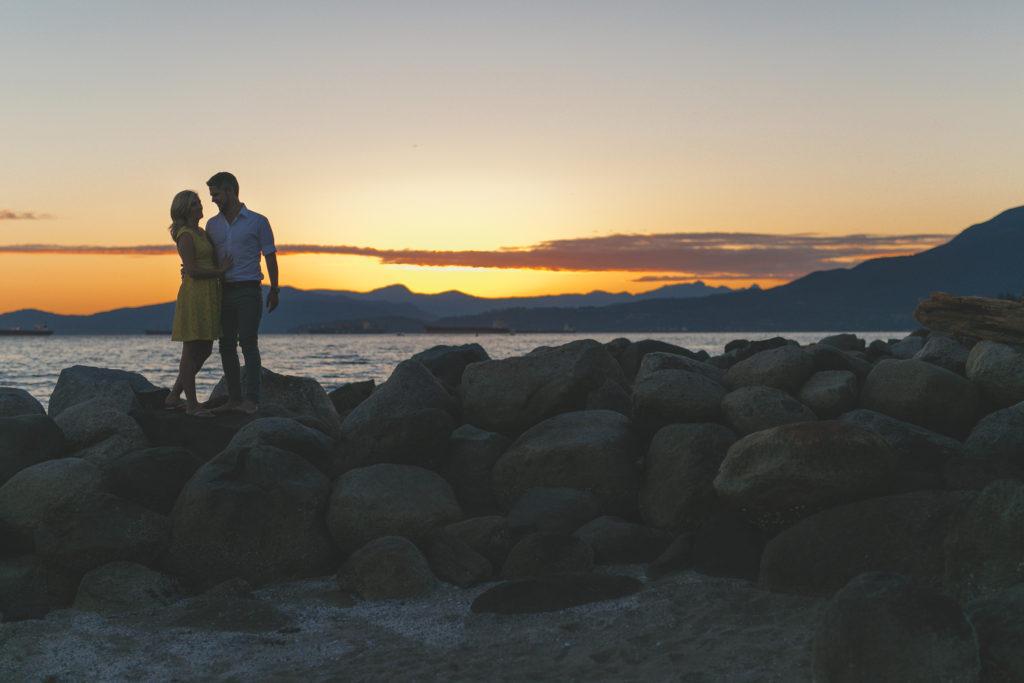 english bay engagement photos at sunset