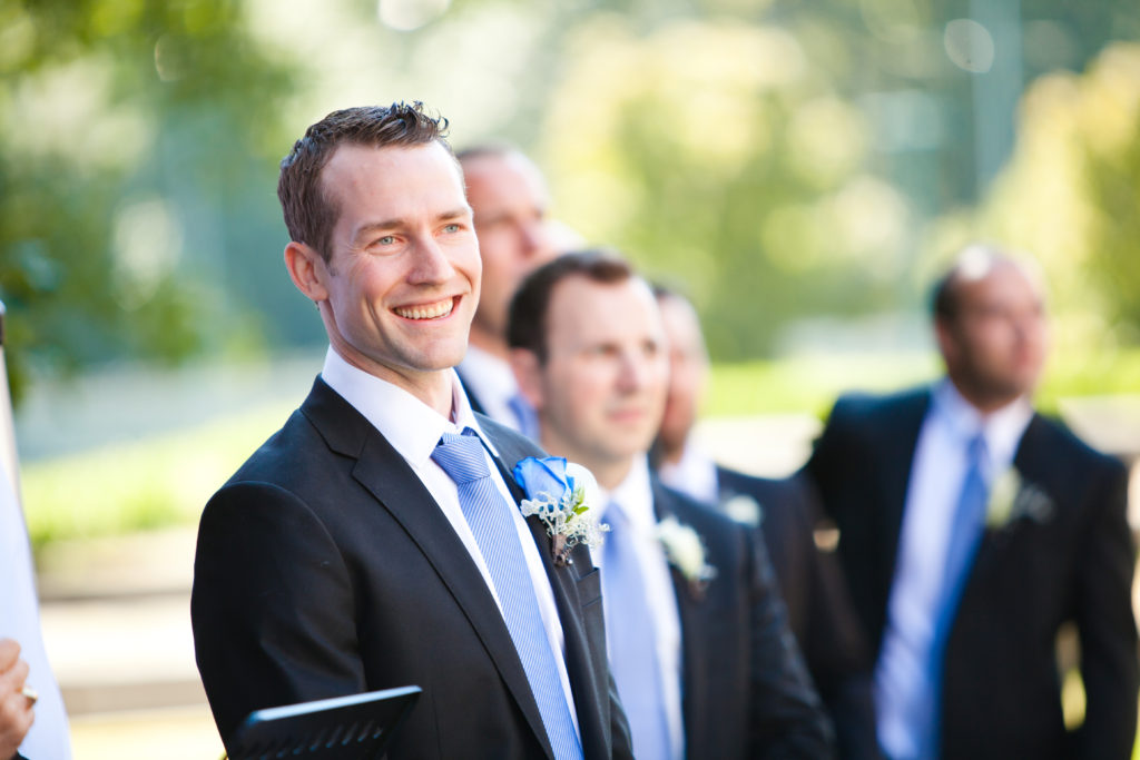 groom excited as bride comes down the aisle, first look