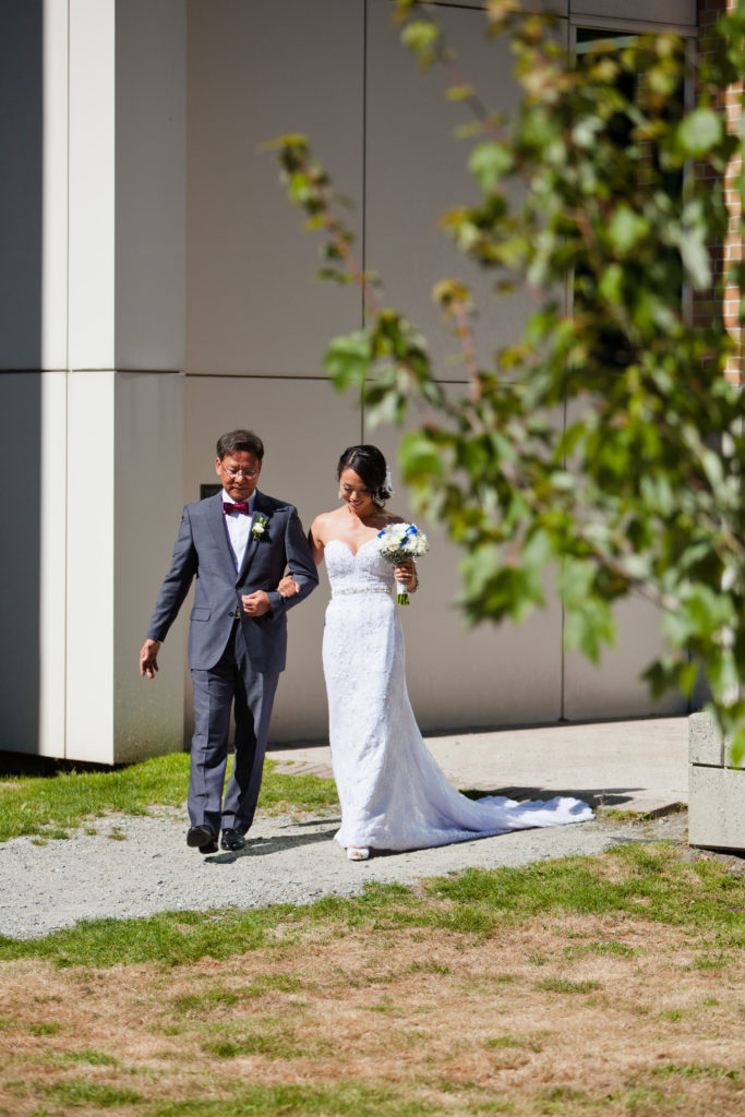 bride walking down the aisle with dad