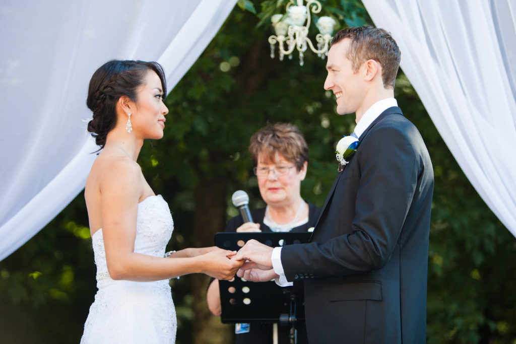 wedding ceremony port moody couple exchanging rings