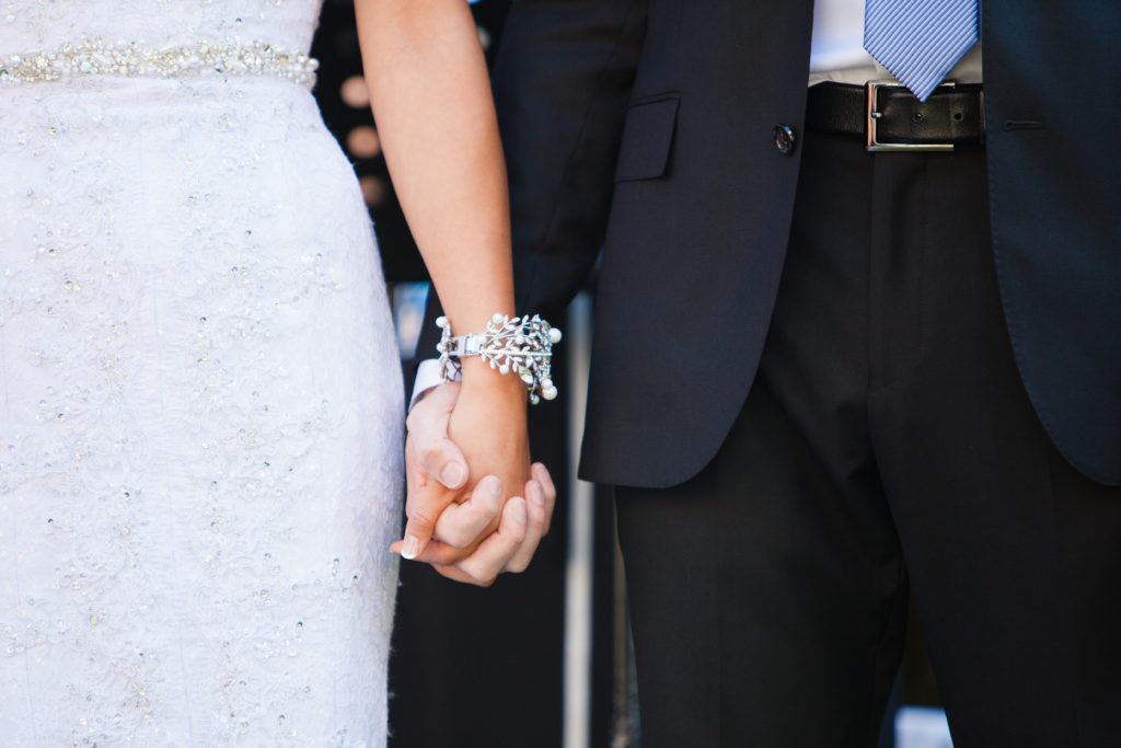 wedding ceremony detail couple holding hands