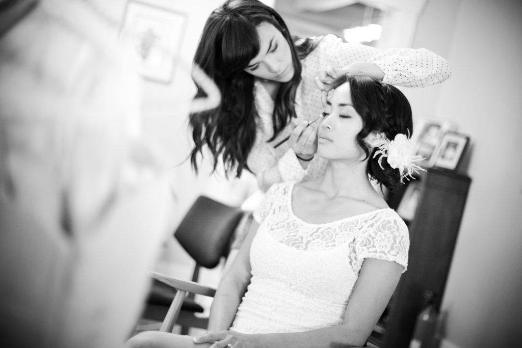 bride getting makeup done, makeup by rae