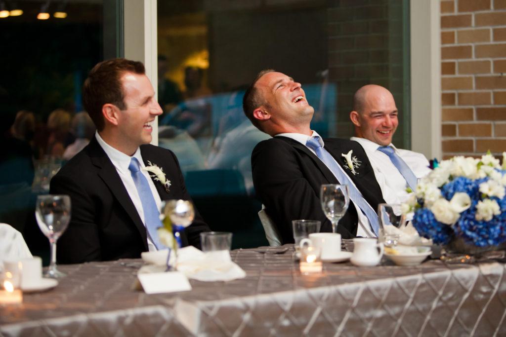 groomsmen laughing at wedding reception port moody