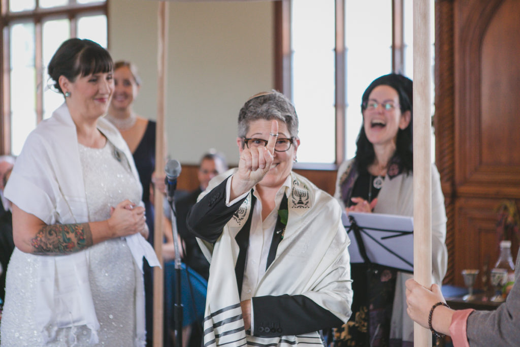 bride showing off ring at jewish wedding ceremony vancouver