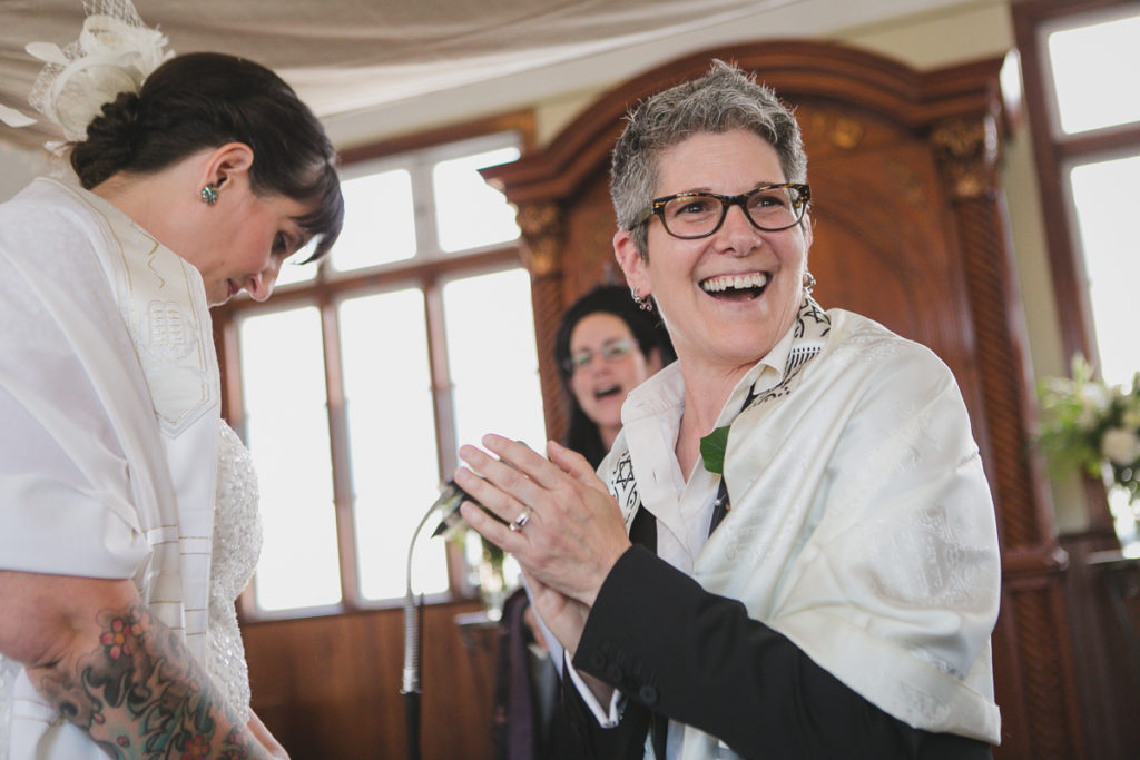 happy couple during ceremony, same-sex wedding vancouver