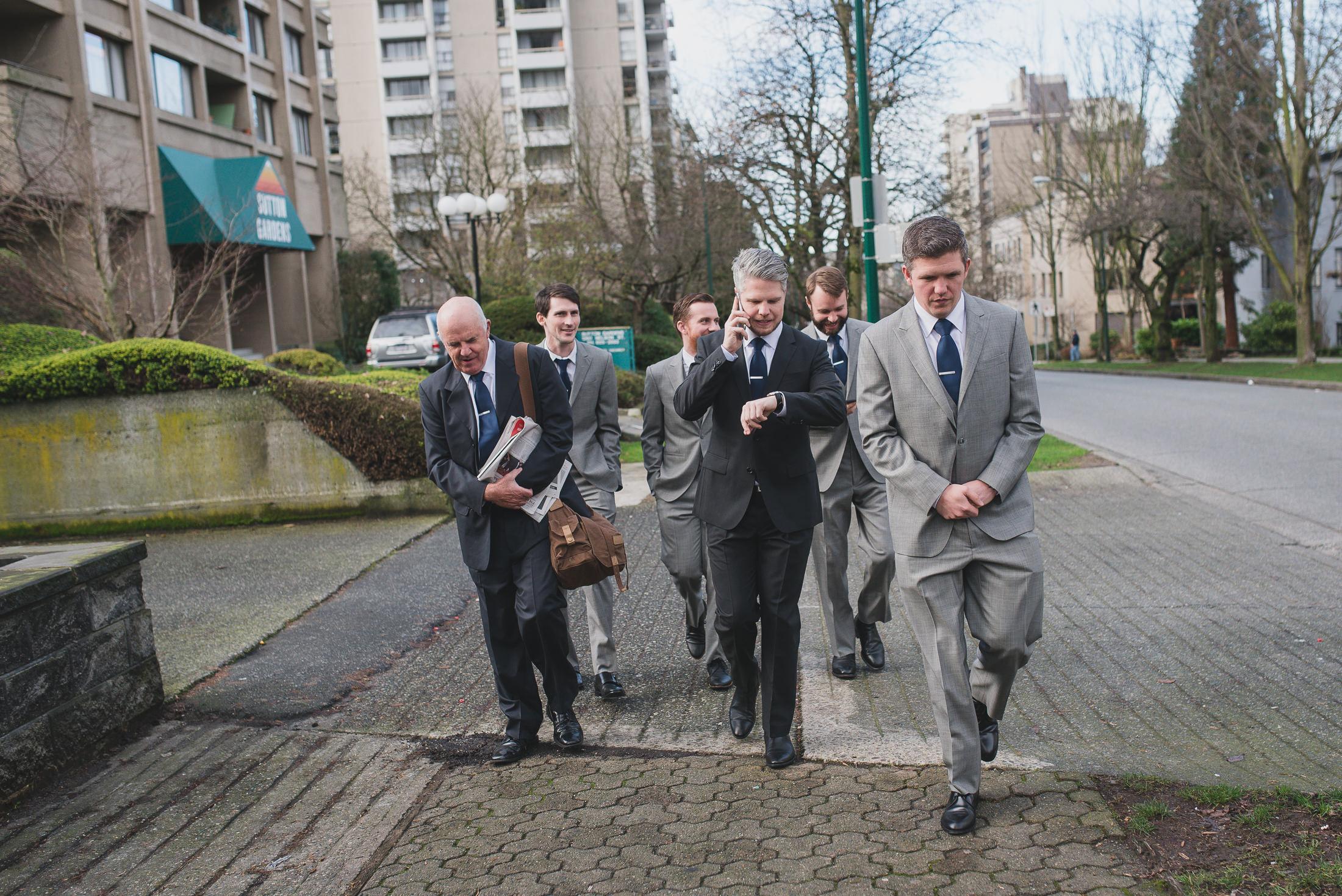 groom and groomsmen walking to vancouver wedding