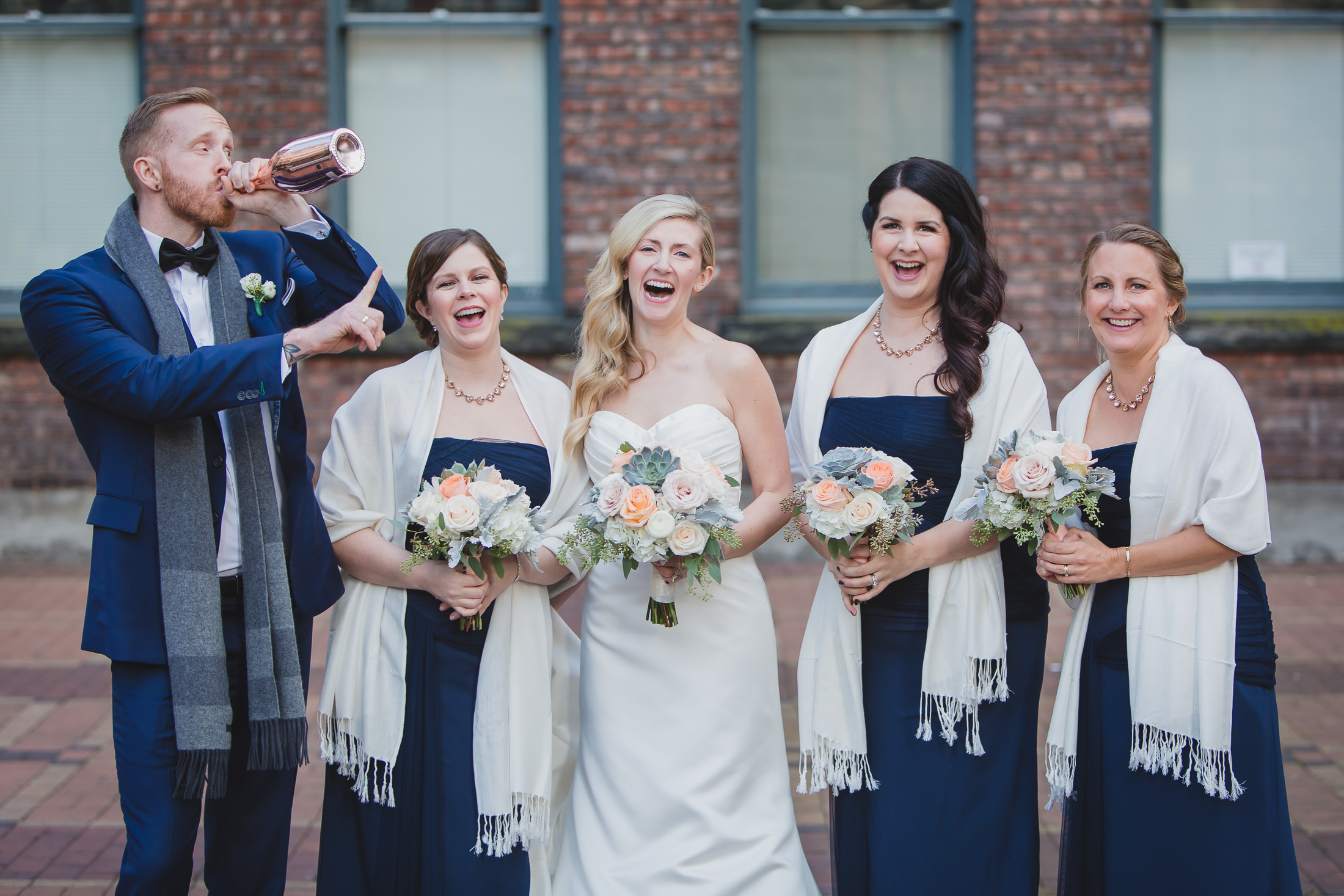 urban wedding party photo in yaletown vancouver, drinking champagne