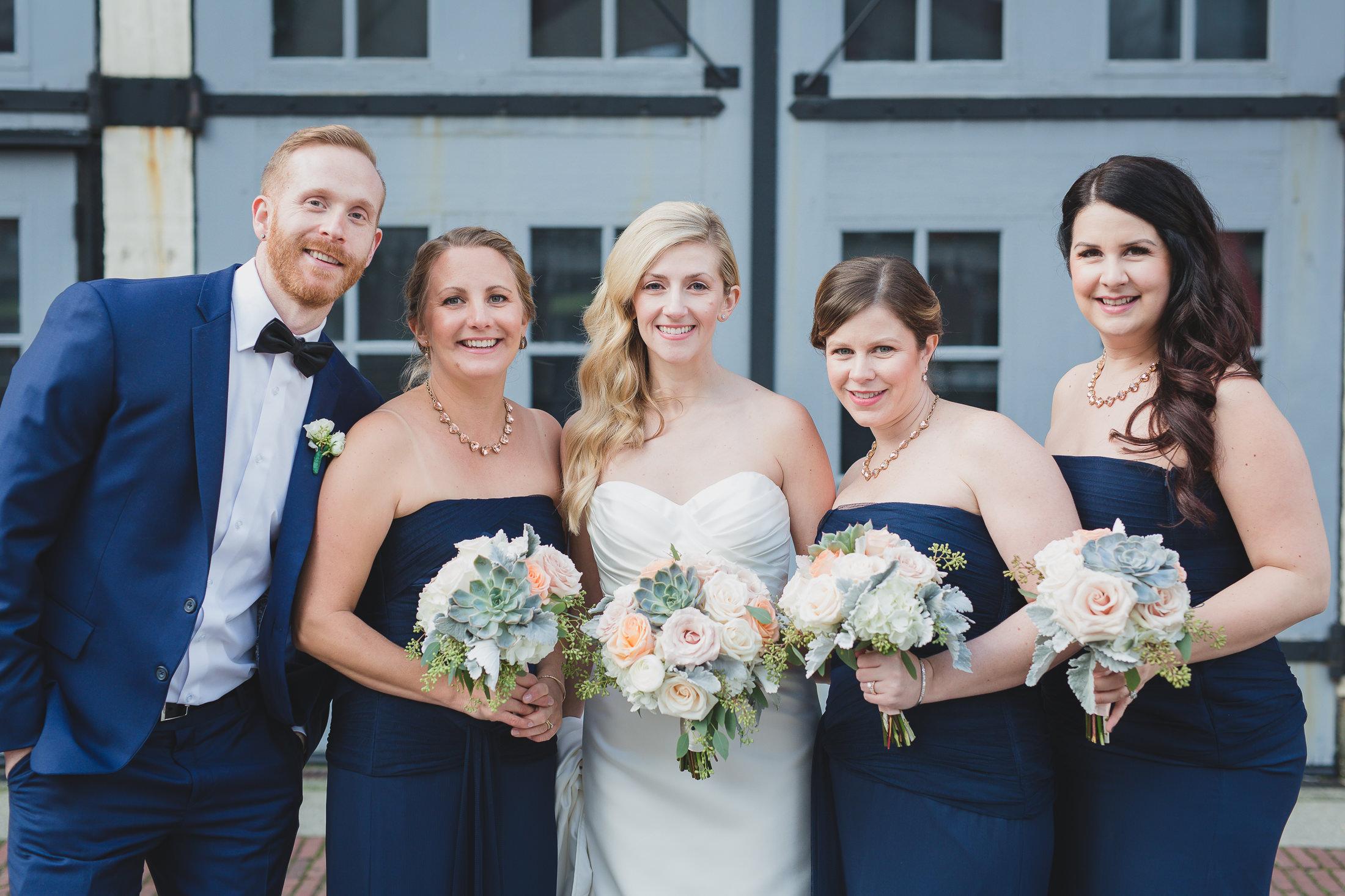 bride with bridesmaids and bridesman portrait