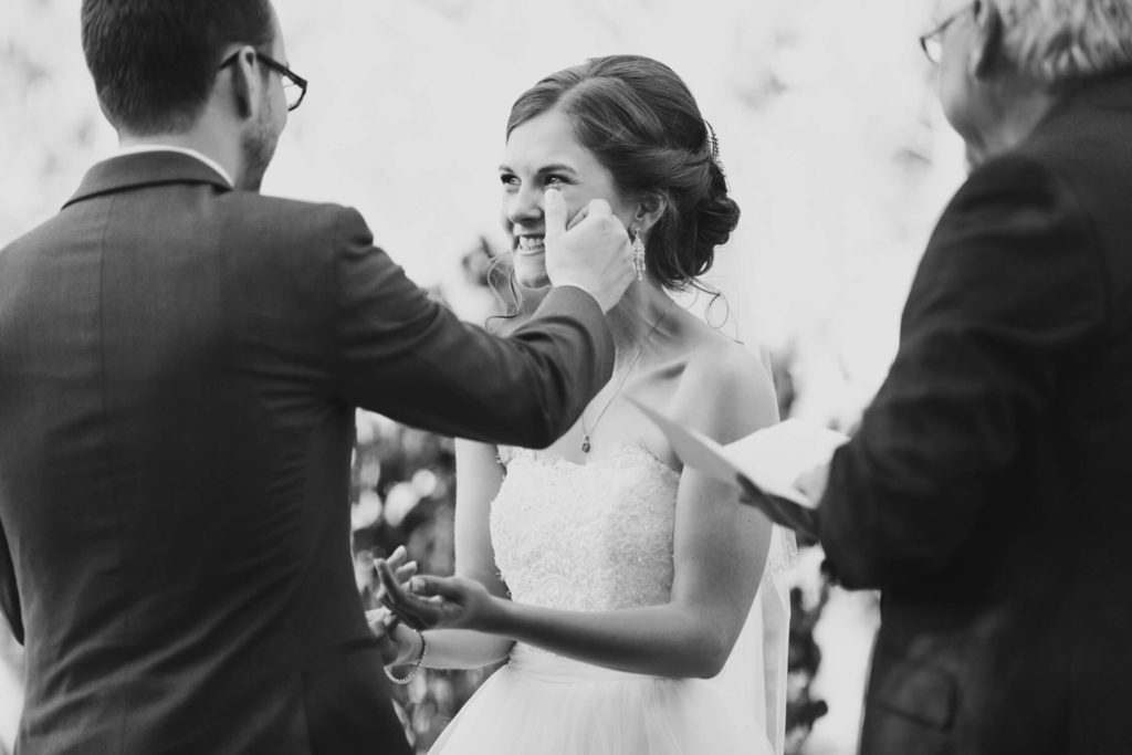 bride crying during ceremony at secret garden at woodbridge ponds in abbotsford wedding