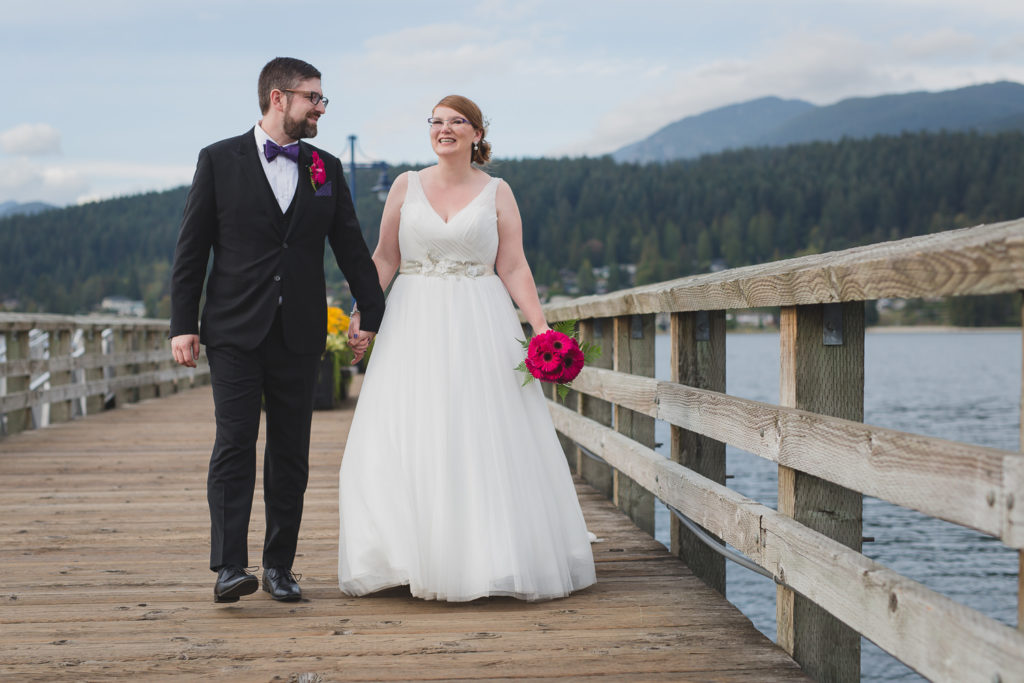 Bride and groom at Rocky Point Park wedding, walking on the dock, by Port Moody wedding photographer