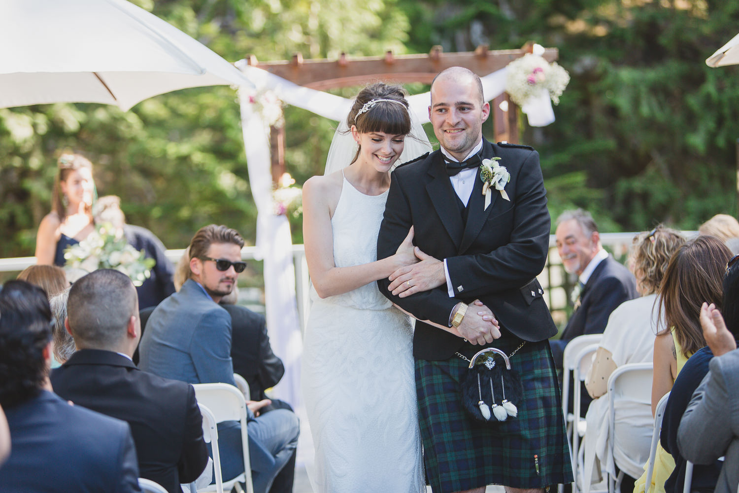 Wedding couple recessional with groom in kilt at Squamish wedding