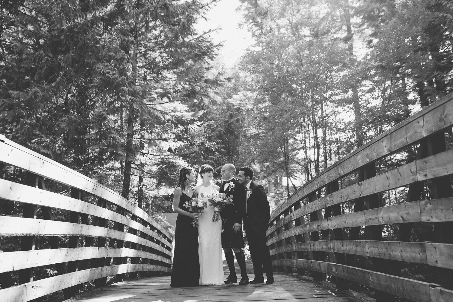 Wedding party on bridge at Furry Creek Gold & Country Club