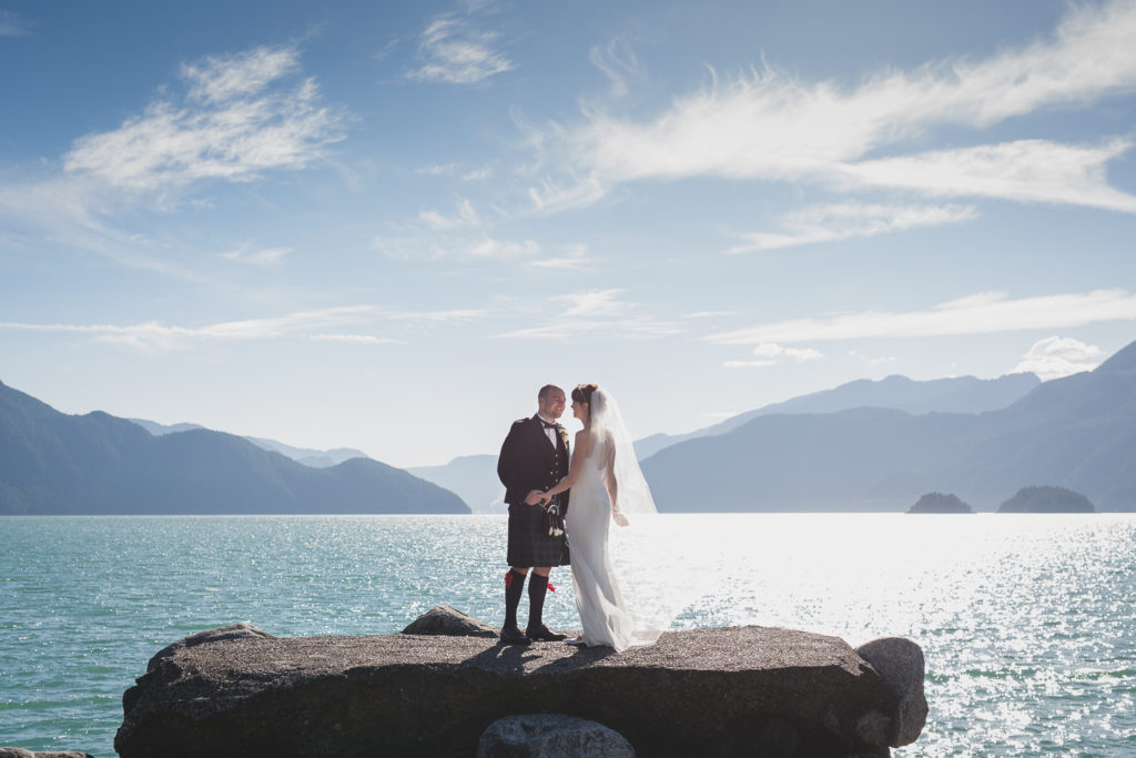 Alternative wedding couple on rocks at Furry Creek Squamish wedding