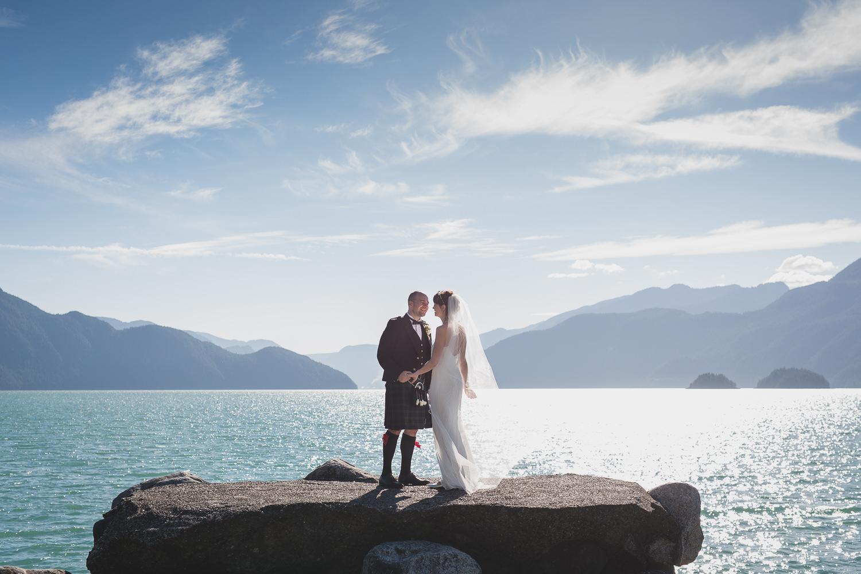 Alternative wedding couple on rocks at Furry Creek Squamish wedding