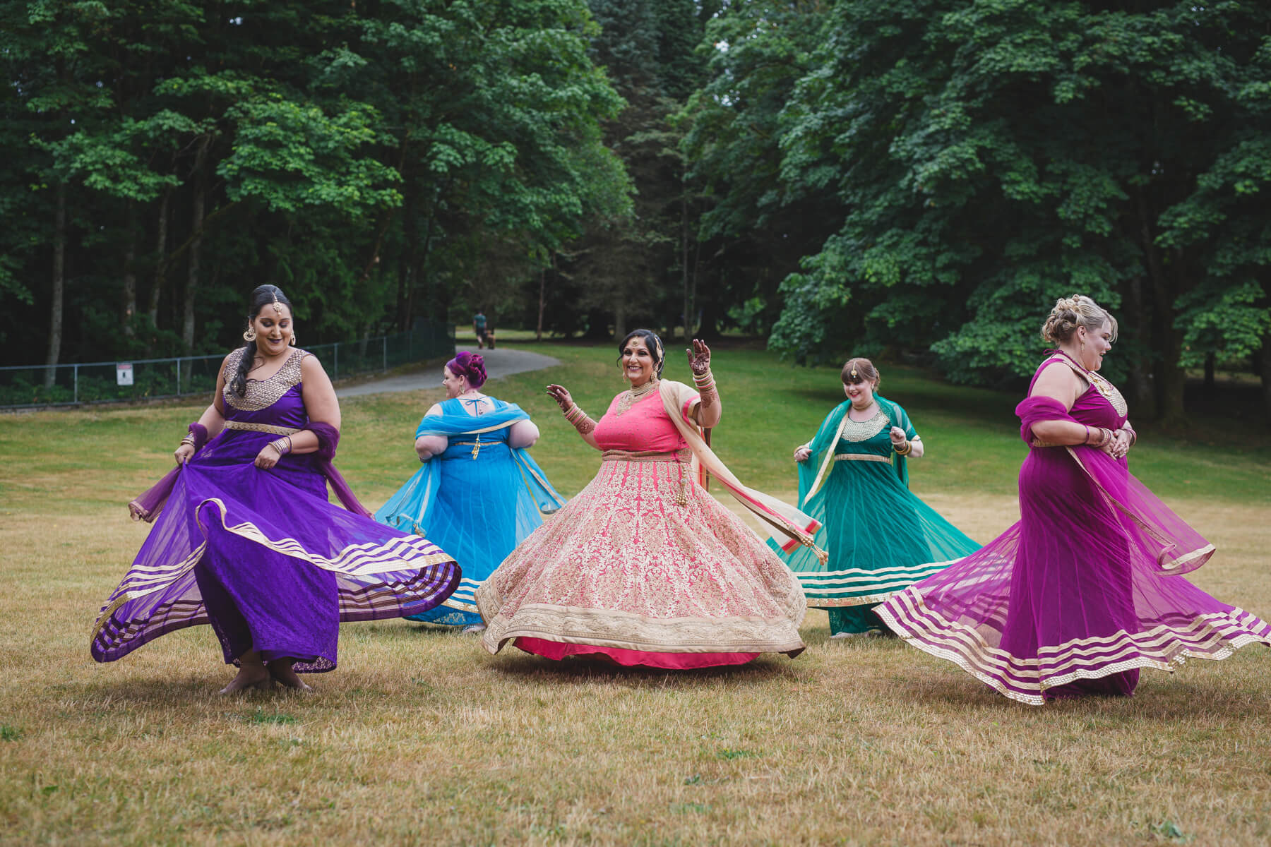 indian bridesmaids spinning portrait