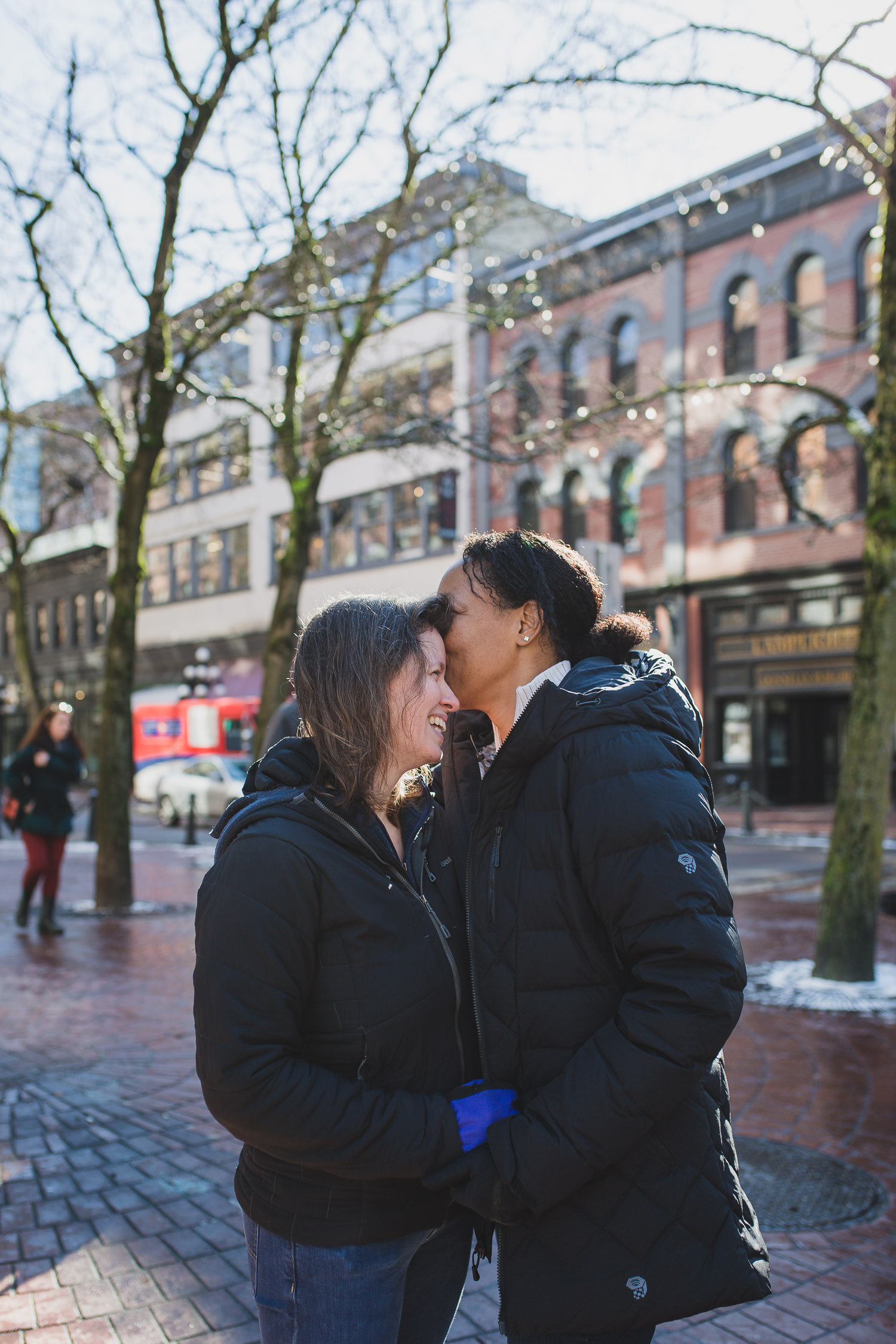 lgbtq couple on gastown street in vancouver
