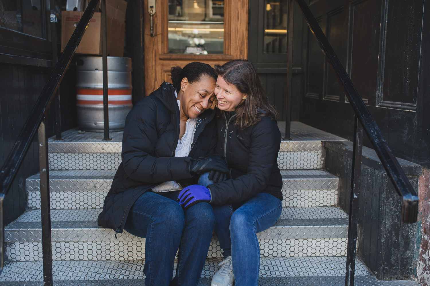 lgbtq couple on steps in gastown