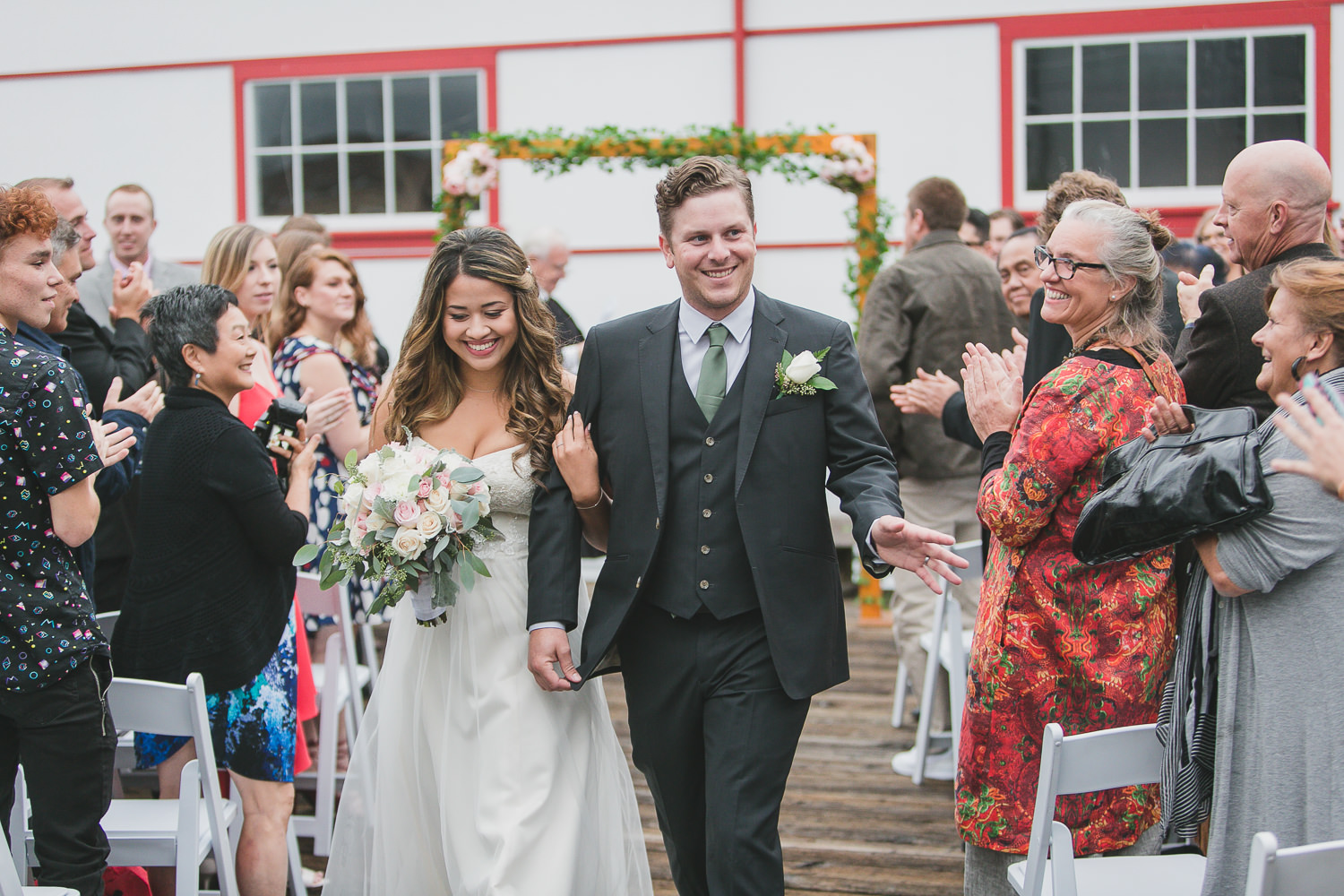 bride and groom recessional with crowd at quirky wedding