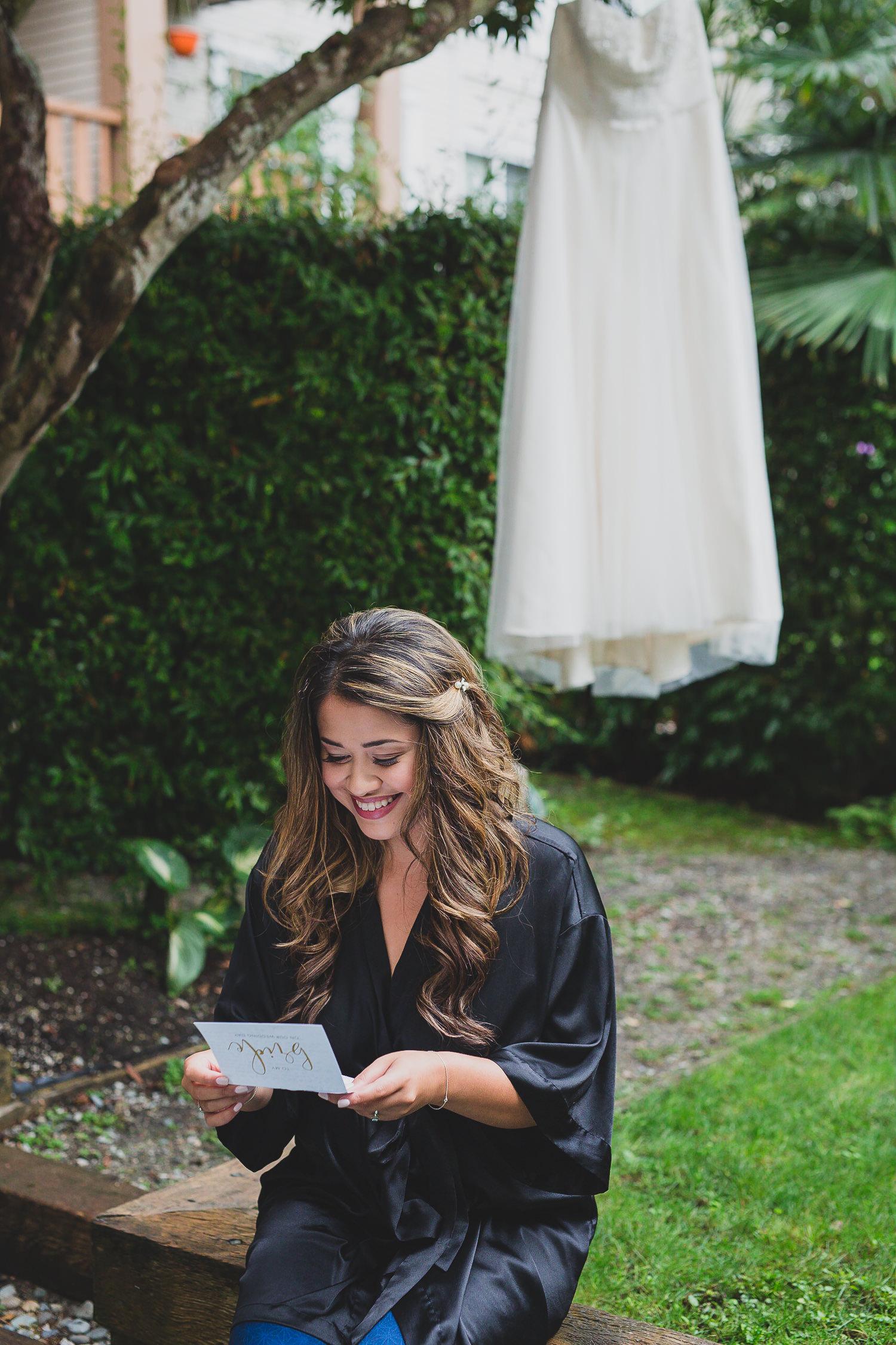 bride reading letter from groom at steveston wedding