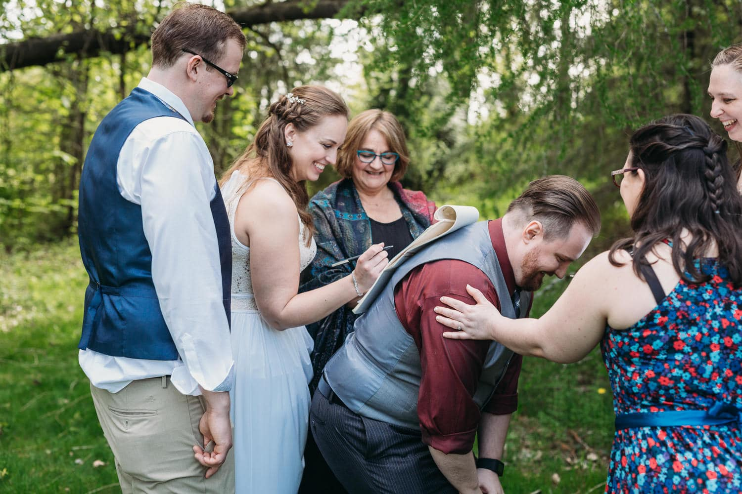 campbell valley park elopement signing on friend's back