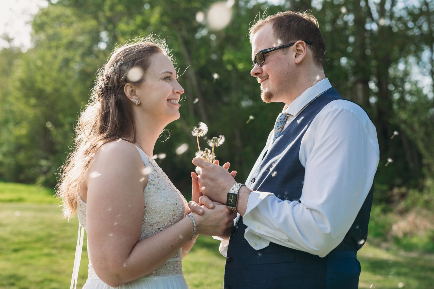 couple with dandelion seeds at vancouver elopement