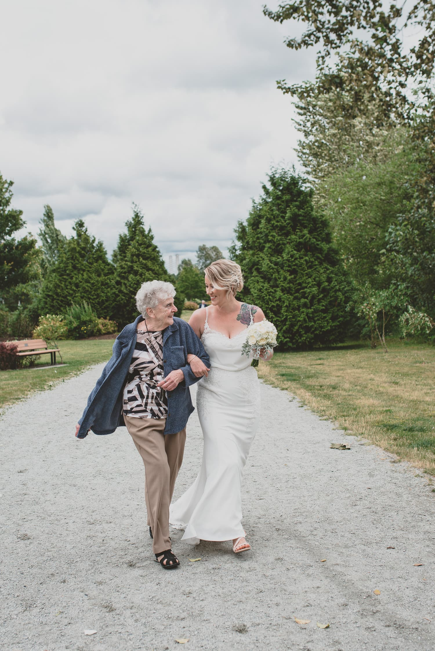 bride walking to wedding ceremony aisle with grandma in Osprey Village Pitt Meadows