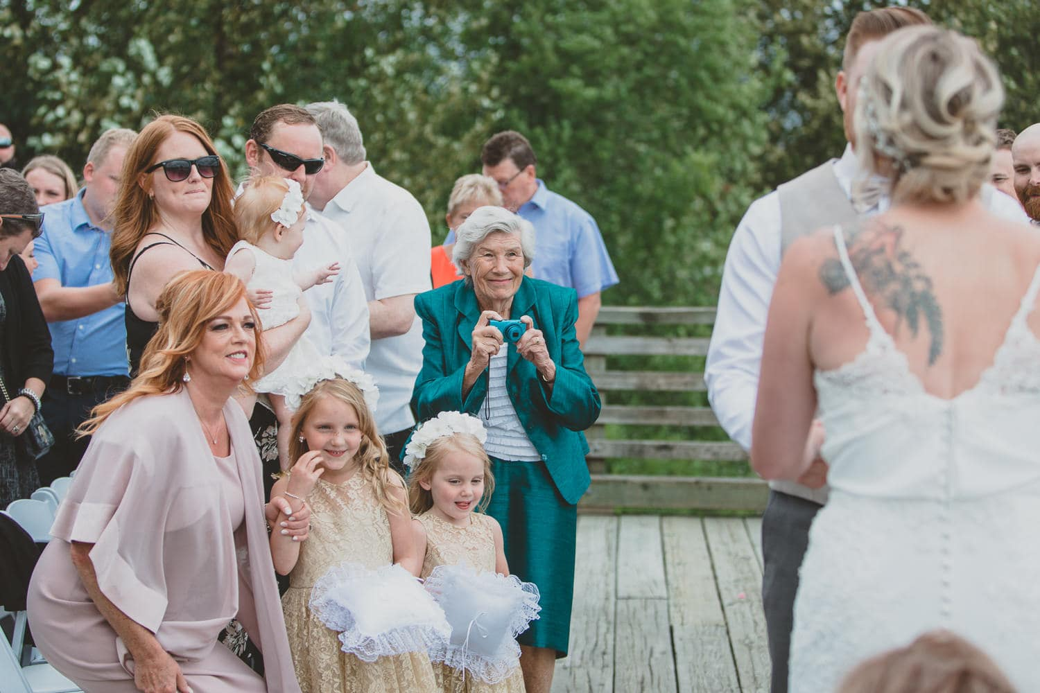 grandma watching wedding ceremony on dock in pitt meadows