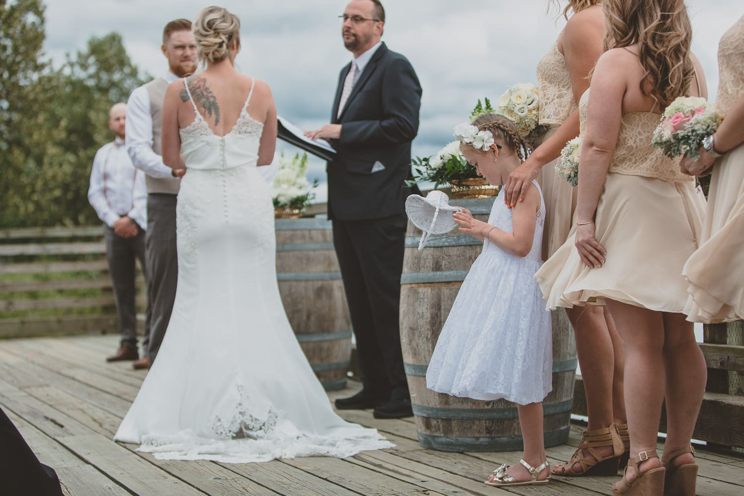 flower girl dumping out basket at wedding ceremony