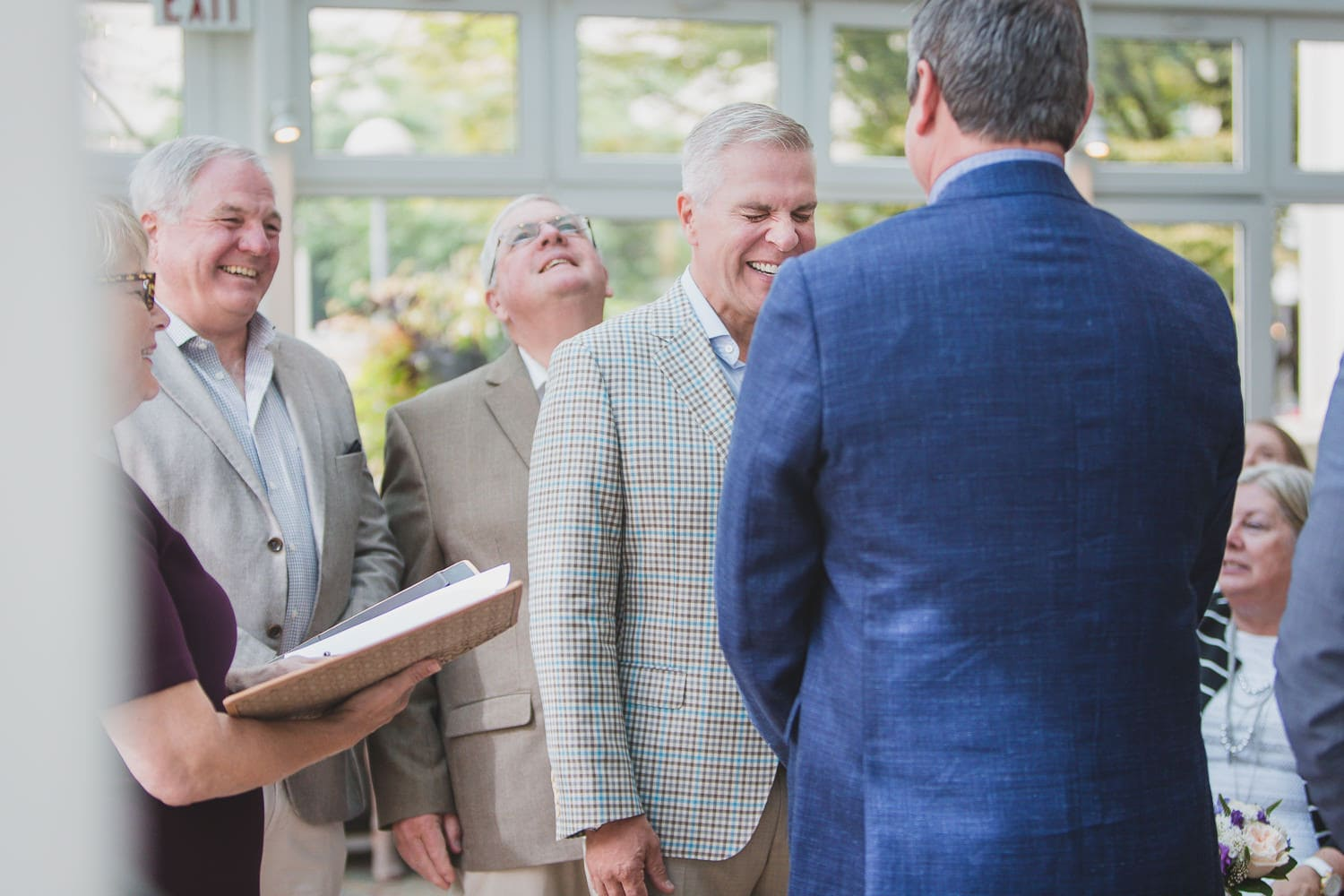laughter at gay wedding ceremony in Vancouver
