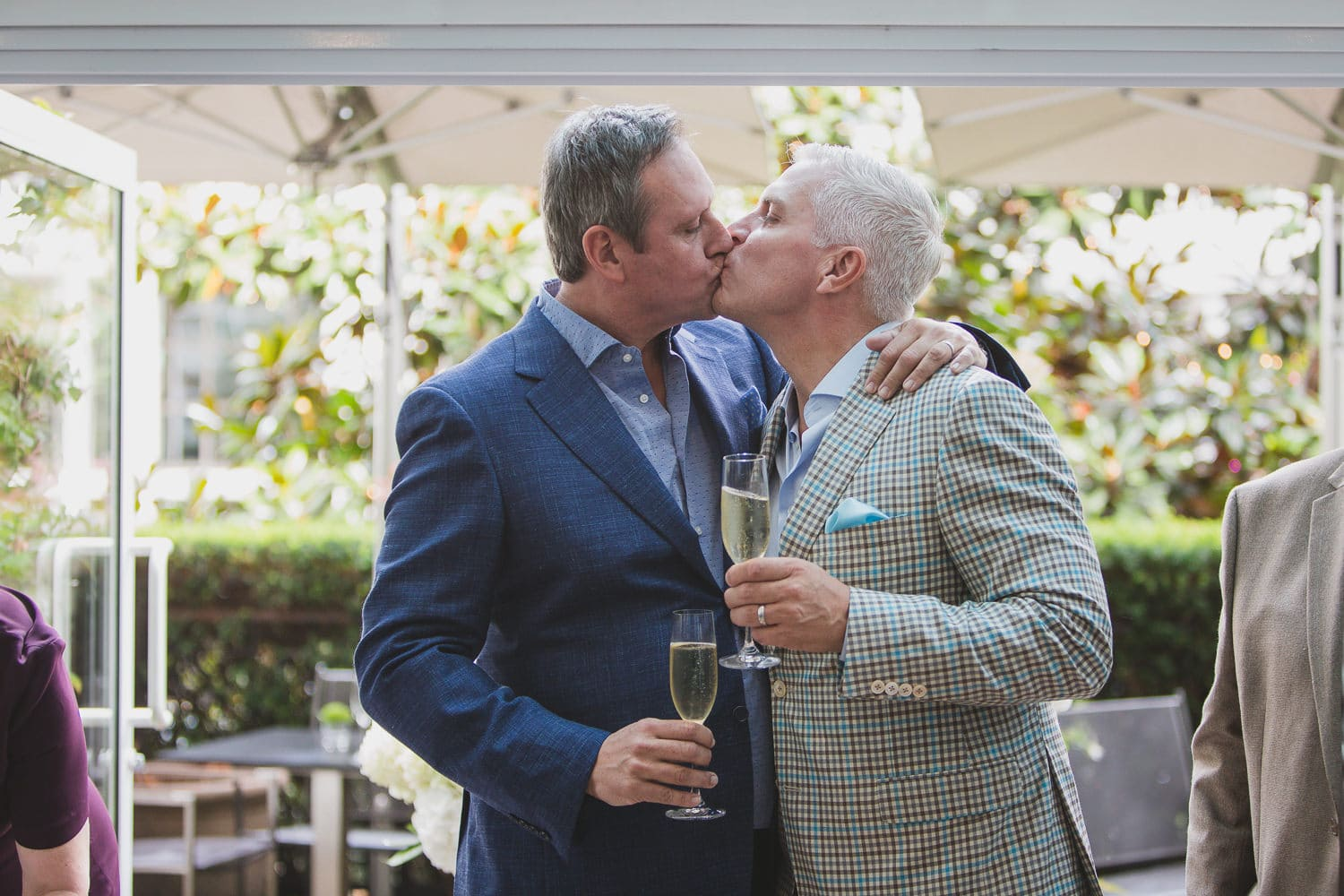 champagne toast after gay wedding ceremony in vancouver