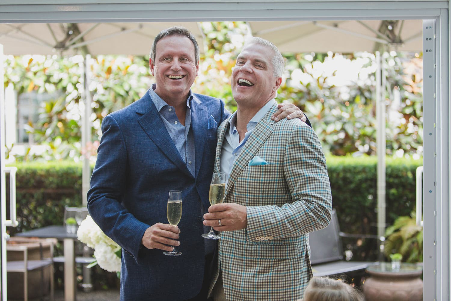 champagne toast laughter after wedding ceremony at Vancouver Club Georgian Room