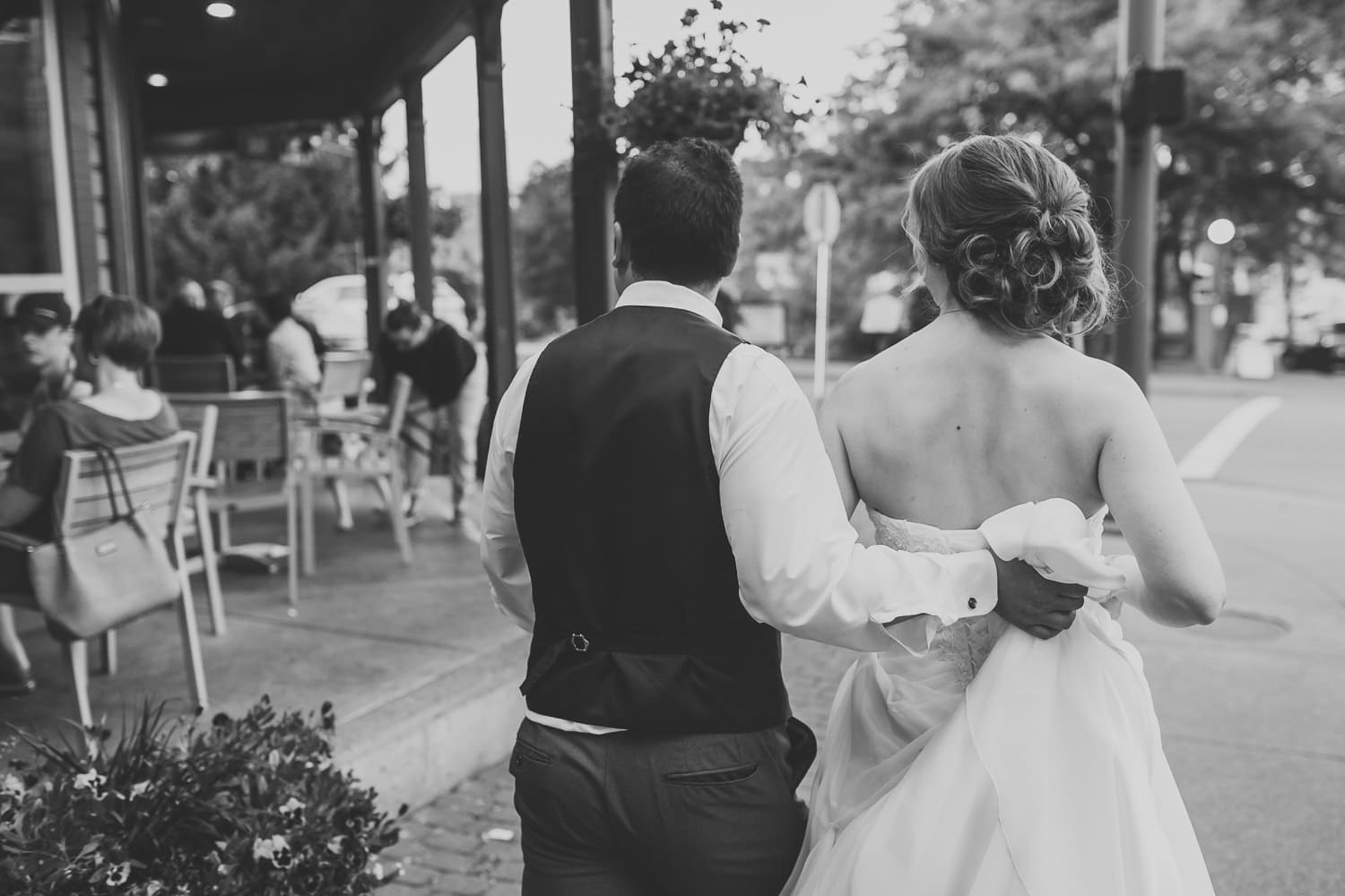 wedding couple walking down the street in fort langley