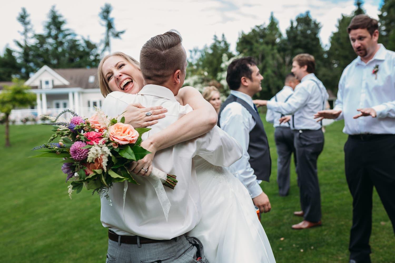 fun hug moment at heronsbridge wedding in abbotsford