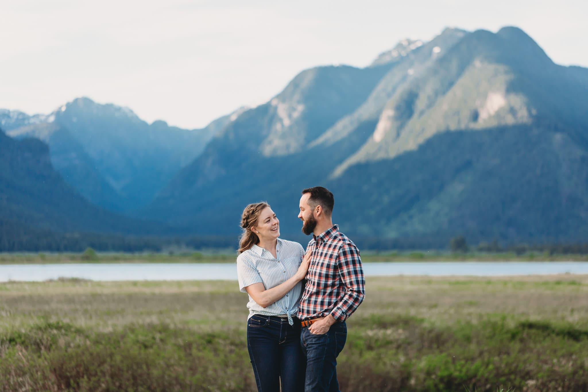 pitt lake engagement photos with mountain backdrop