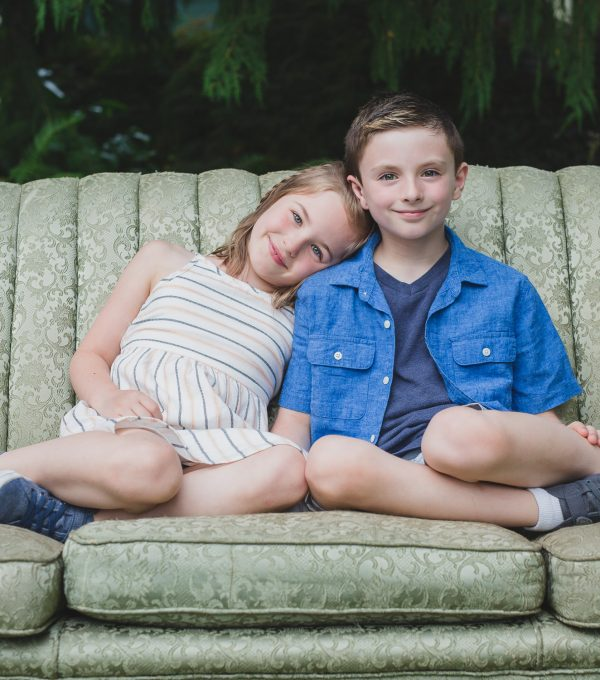 brother and sister on vintage couch in fraser valley farm mini session